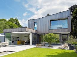 designs for homes ilike the tree in the middle of the patio area grand designs