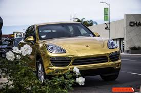 porsche wrapped project 24k gold porsche cayenne gold chrome vinyl wrap unique