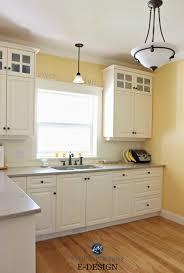 oak cabinets benjamin moore suntan yellow in kitchen with quartz painted cream