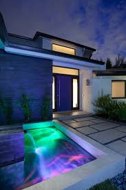 modern water feature waterfall water feature colored lighting modern retreat in