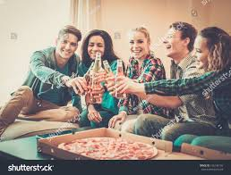 group young multiethnic friends pizza bottles stock photo
