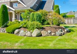 flowers stones nicely trimmed bushes front stock photo 171719519
