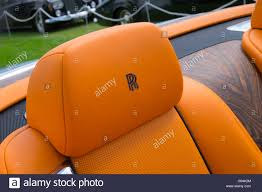 roll royce orange orange headrests on a rolls royce wraith with the rr emblem stock
