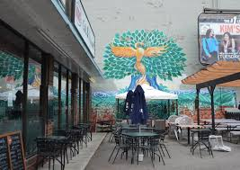 herringbone as i walk toronto mural on an exterior wall outside kos restaurant on bathurst street the mural is in