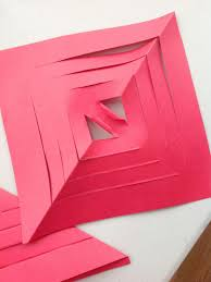 make a paper snowflake star christmas ornament hgtv