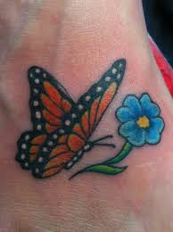 monarch butterfly tattoo and forget me not flower in memory of a