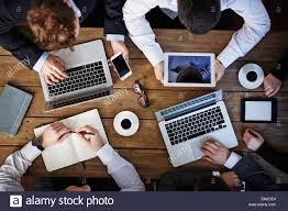 group of business people using modern gadgets at workplace stock