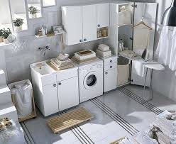 white and colored laundry room cabinets from idea group digsdigs