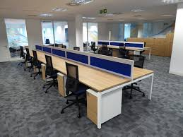 new open plan office space with blue desk dividers separating the new open plan office space with blue desk dividers separating the office furniture bellway plc