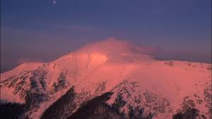timelapse of winter mountain covered by fog with colorful
