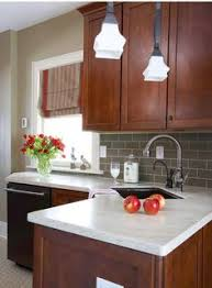 Medium Brown Kitchen Cabinets by Dark Kitchen Cabinets And White Appliances Not Bad For The