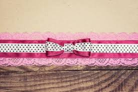 and white polka dot ribbon vintage background with wood paper and pink and white polka