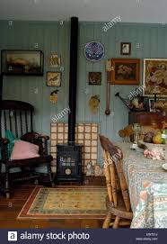 small wood burning stove in nineties dining room with painted wood
