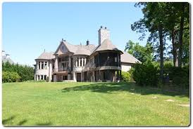 executive french country waterfront foreclosure home for sale