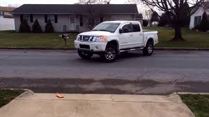 nissan titan jacked up 2013 nissan titan on 35 u0027s with 40 series flowmaster exhaust