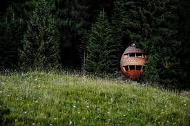 these tree houses in the dolomites look like egg shaped pinecones