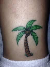 green ink palm tree on leg