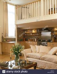 Living And Kitchen Design by Cream Sofa Below Mezzanine Floor In Open Plan Living And Kitchen
