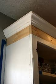 how to add crown molding to kitchen cabinets 1 x 4 to add height to cabinet before attaching crown molding and