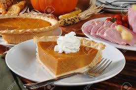 history of thanksgiving dinner a slice of pumpkin pie on a thanksgiving dinner table stock photo