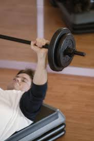 bench press machines vs free weights livestrong com