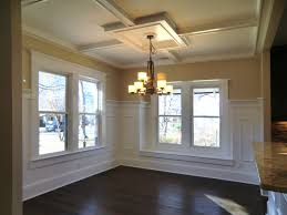 ceiling dining room with coffered ceiling with chandelier and