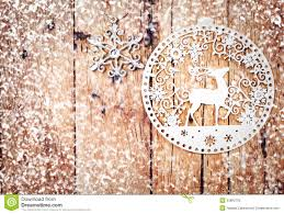 white ornaments on rustic wooden board stock photo