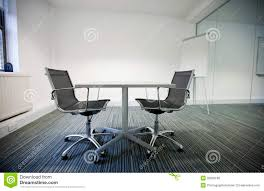 small table with two chairs side view of small table and two chairs in office stock photo