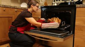 Toaster Oven Turkey Woman Gets Thanksgiving Turkey Out Of Oven Stock Footage Video