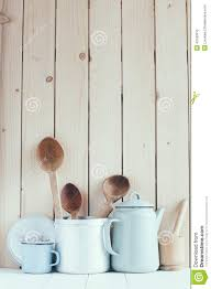 coffee pot enamel mugs and rustic spoons stock photo image