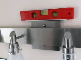 How To Change Light Fixture In Bathroom How To Replace A Bathroom Light Fixture How Tos Diy