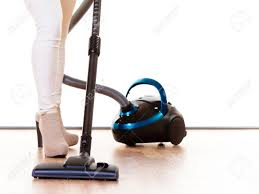Vaccumming Woman Vacuuming The House Female Legs With Vacuum Cleaner
