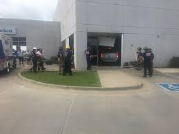 chrysler jeep dodge dealership police no serious injuries after van drives into south tulsa car