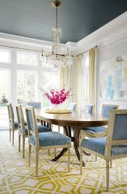 best 25 yellow dining room ideas on pinterest yellow dining dark ceiling floor to ceiling windows replicate the proportions of traditionally southern triple hung windows and flood the dining room with natural