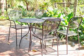 Outdoor Metal Chairs Metal Chairs And Table In Garden Deck Stock Photo Picture And