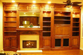 built in entertainment center around fireplace