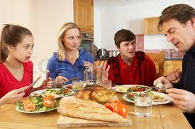 family eating lunch together in kitchen stock photo colourbox