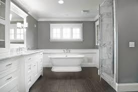 wood plank tile bathroom beach with baseboard bathtub bright