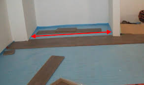 Laminate Floor Glue How To Install Laminate Wood Flooring Under A Closet Door