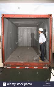 man standing inside empty container stock photo royalty free