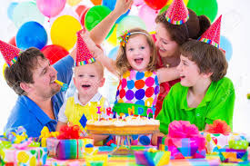 kids birthday party happy family celebrating kids birthday parents and three children