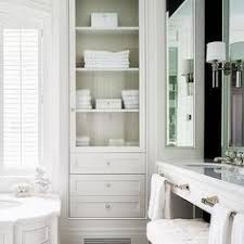 bathroom linen cabinet with glass doors store more in your bathroom with these smart storage ideas storage