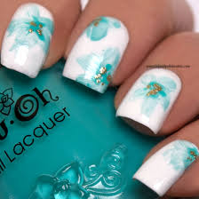 beautiful blue hues of color on white nail polish to create the