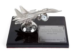 roll royce brasil a trophy featuring a model of an f14 style fighter jet presented