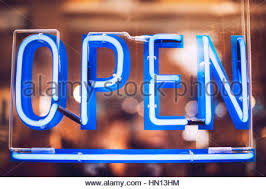 Open Light Up Sign Close Up Crop Neon Light Sign Jazz Of Orange Color In Dark Stock
