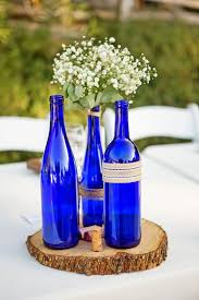 rustic country wedding at lake oak meadows blue glass bottles