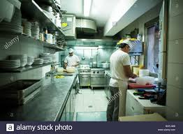 Professional Kitchen People Working In A Small Professional Kitchen Trattoria Da Bepi