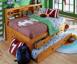 bedroom boys bed room with brown stained wooden storage bed and