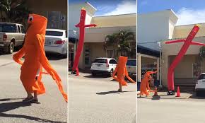 African Kid Dancing Meme - woman in inflatable tube man costume dances alongside the real thing
