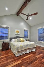 western home decor catalog photos hgtv transitional bedroom boasts high ceilings warm wood